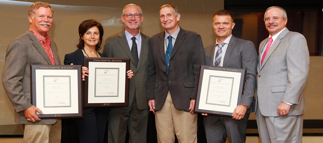 Martin and two fellow Provost Award recipients and presenters in 2015